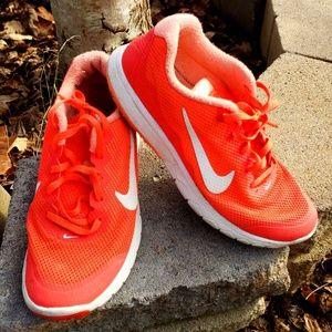 Neon orange Nikes womans size 7.5